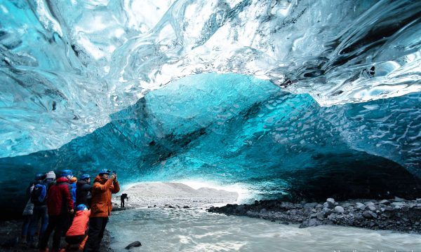 Crystal blue ice cave under the vatnajokull glacier