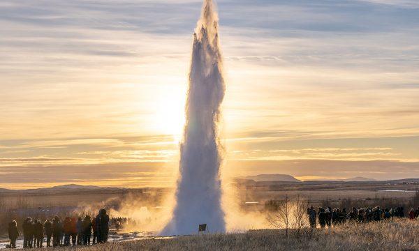 Eruption at Strokkur geyser at sunset