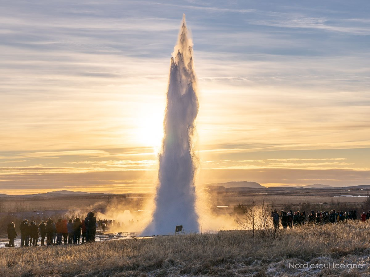 Eruption at Strokkur geyser at sunset