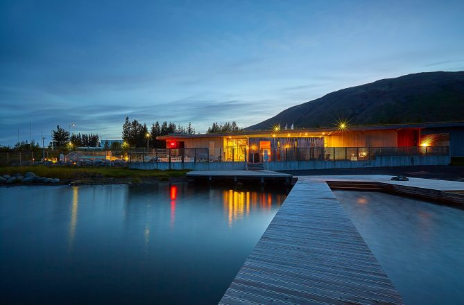 The newly renovated Fontana geothermal Spa viewed from the lake under the midnight sun