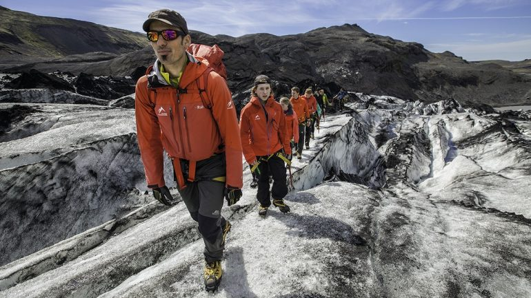 Customers being guided by professionals on a glacier hiking tour