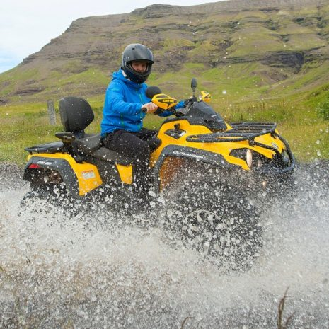 Quad bike passing a river