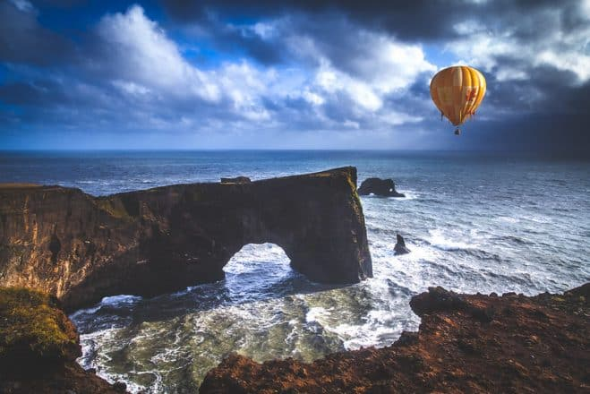 A hot air balloon over Dyrhólaey in South Iceland