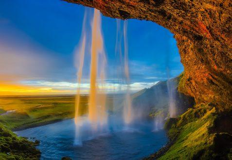 Sunrise behind Seljalandsfoss waterfall