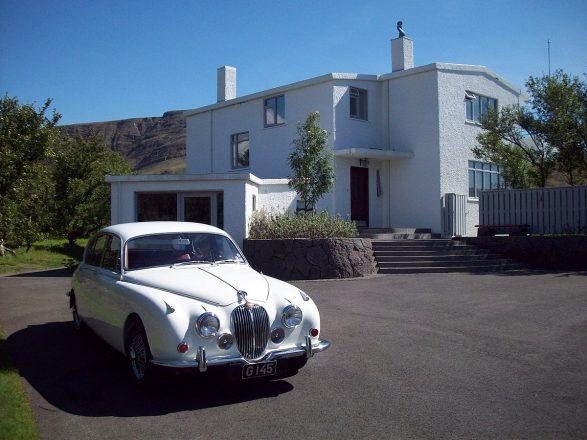A jaguar in front of the house Gljúfrasteinn.
