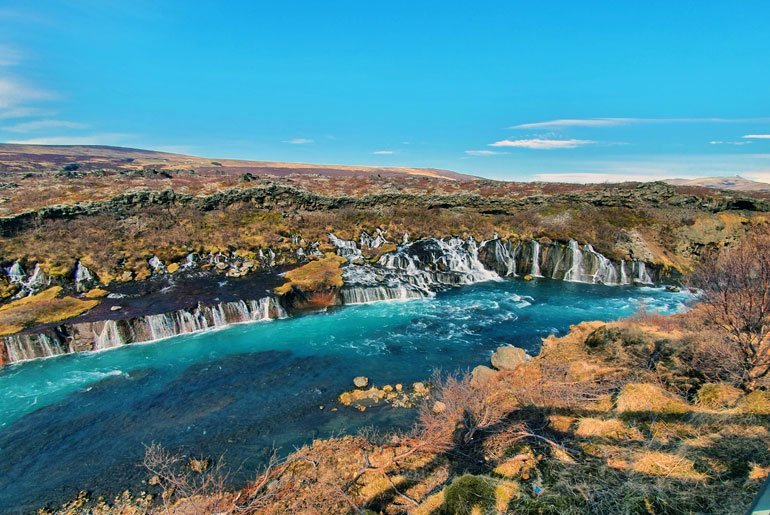 Hraunfossar waterfall with turquoise glacial water from Langjökull forming the Hvítá river