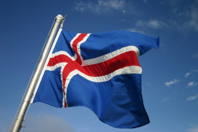 The Icelandic flag blowing in the wind.