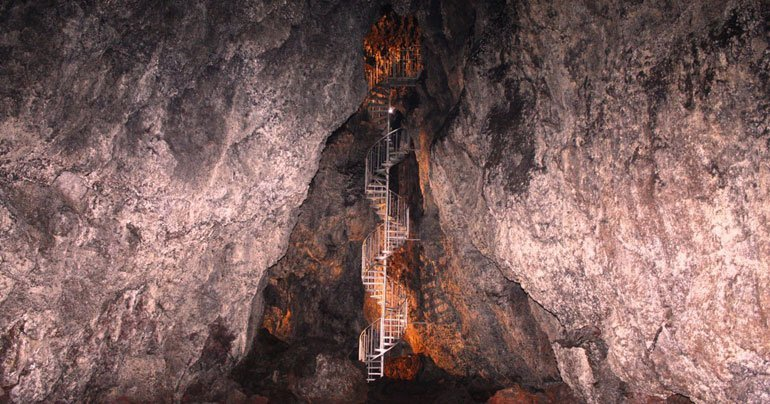 Inside Vatnshellir lava cave on the snaefellsnes peninsula with stairs going down the cave