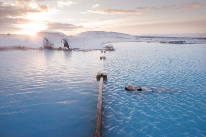 Person floating in the Myvatn Nature baths in the winter