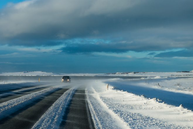 Driving down an icy road in Iceland