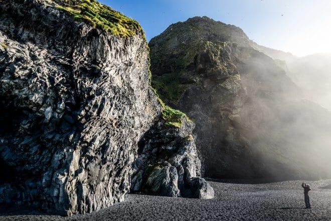 A photographer captures Reynisfjara beach