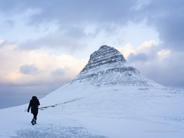 A person next to Mt. Kirkjufell on the Snaefellsnes Peninsula