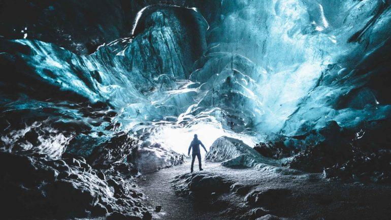 A traveller deep inside an Icelandic ice cave