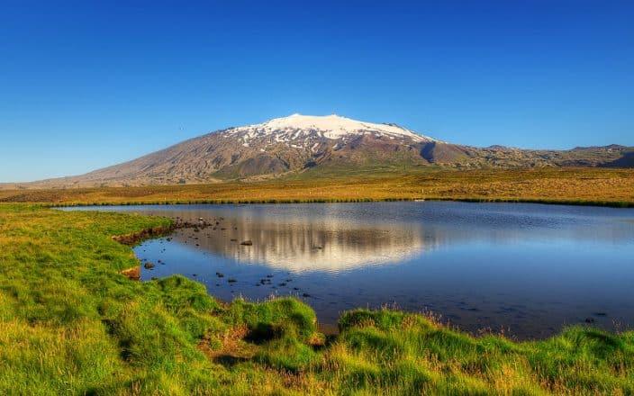 Snaefellsjokull Glacier reflecting in a calm lake.