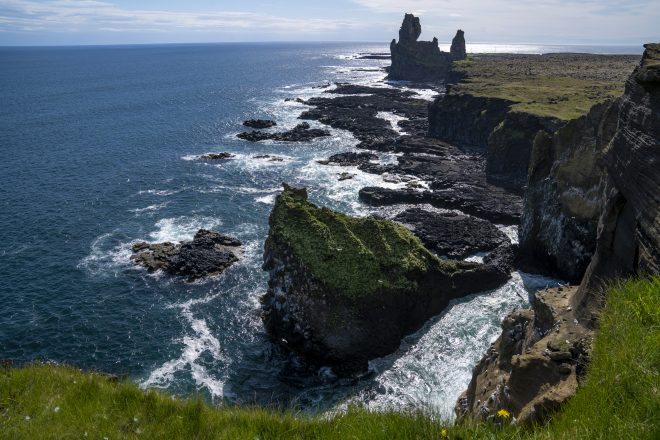 A view of the cliffs of Snaefellsnes Peninsula with the rock stacks of Londragar protruding out of the ocean.
