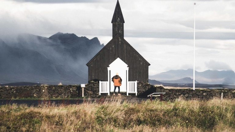 In front of the black Budarkirkja Church on the Snaefellsnes Peninsula.