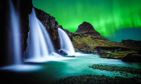 Northern lights above Kirkjufell mountain on the Snaefellsnes Peninsula.