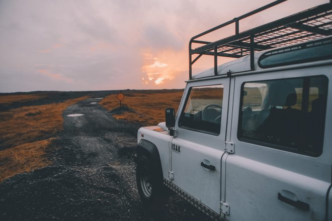 A white van in front of a sunset in Iceland