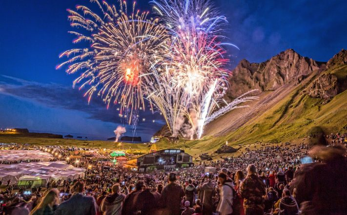 Fireworks and crowds in Herjolfsdalur Valley.