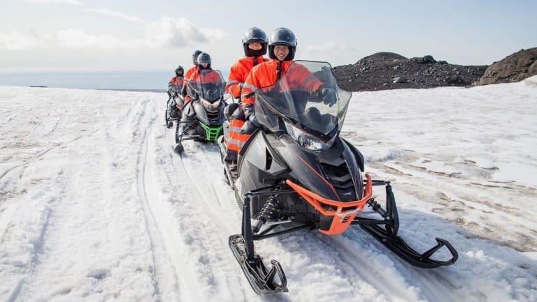 Snowmobiling atop Myrdalsjokull Glacier in South Iceland