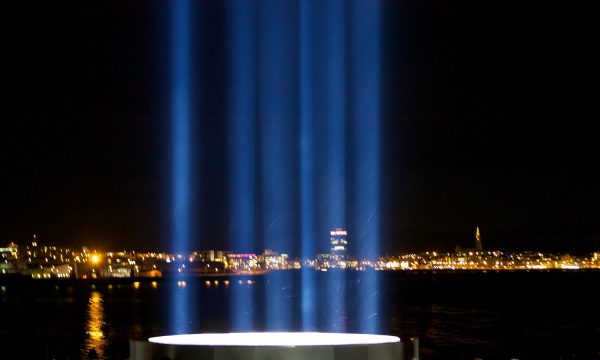Reykjavik through the beams of the Imagine Peace Tower.