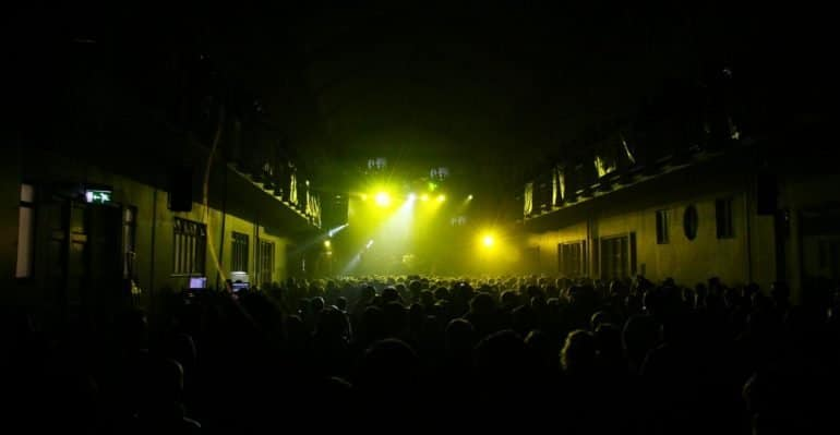 Yellow lights illuminating a concert at Iceland Airwaves.