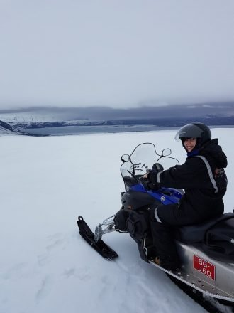 A girl on a snowmobile on top of Langjokull Glacier