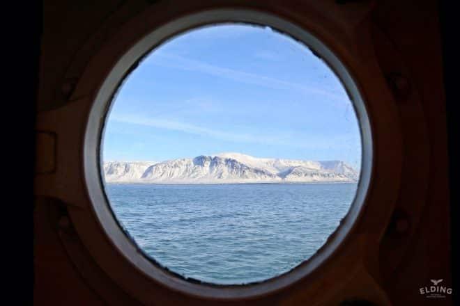 Mount Esja through a port hole.