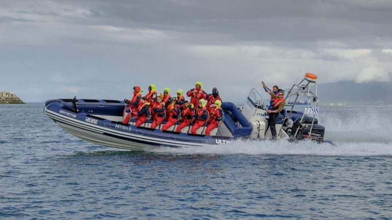 An RIB boat on a whale watching tour in Iceland.