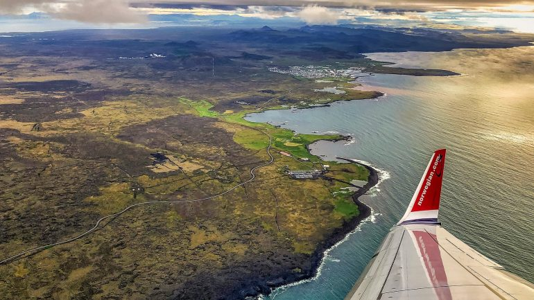 A plane tipping its wing over Iceland