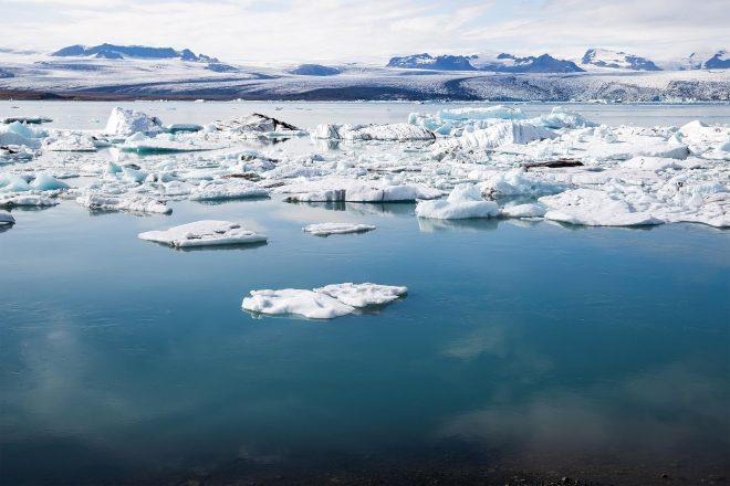 Icebergs floating on still water at Jökulsárlón Glacier Lagoon