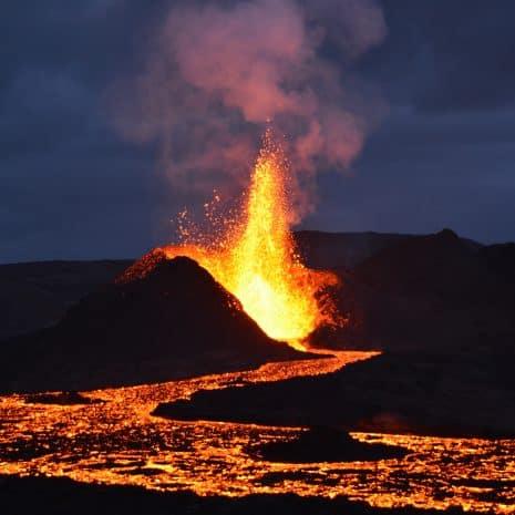A caldera spewing lava in the night.