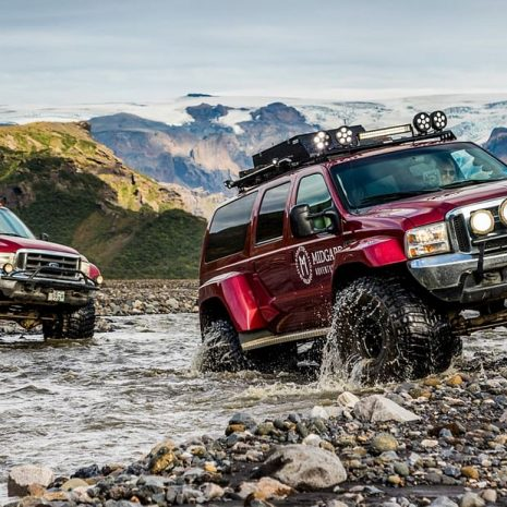 Two Jeeps crossing a river in the Icelandic Highlands.