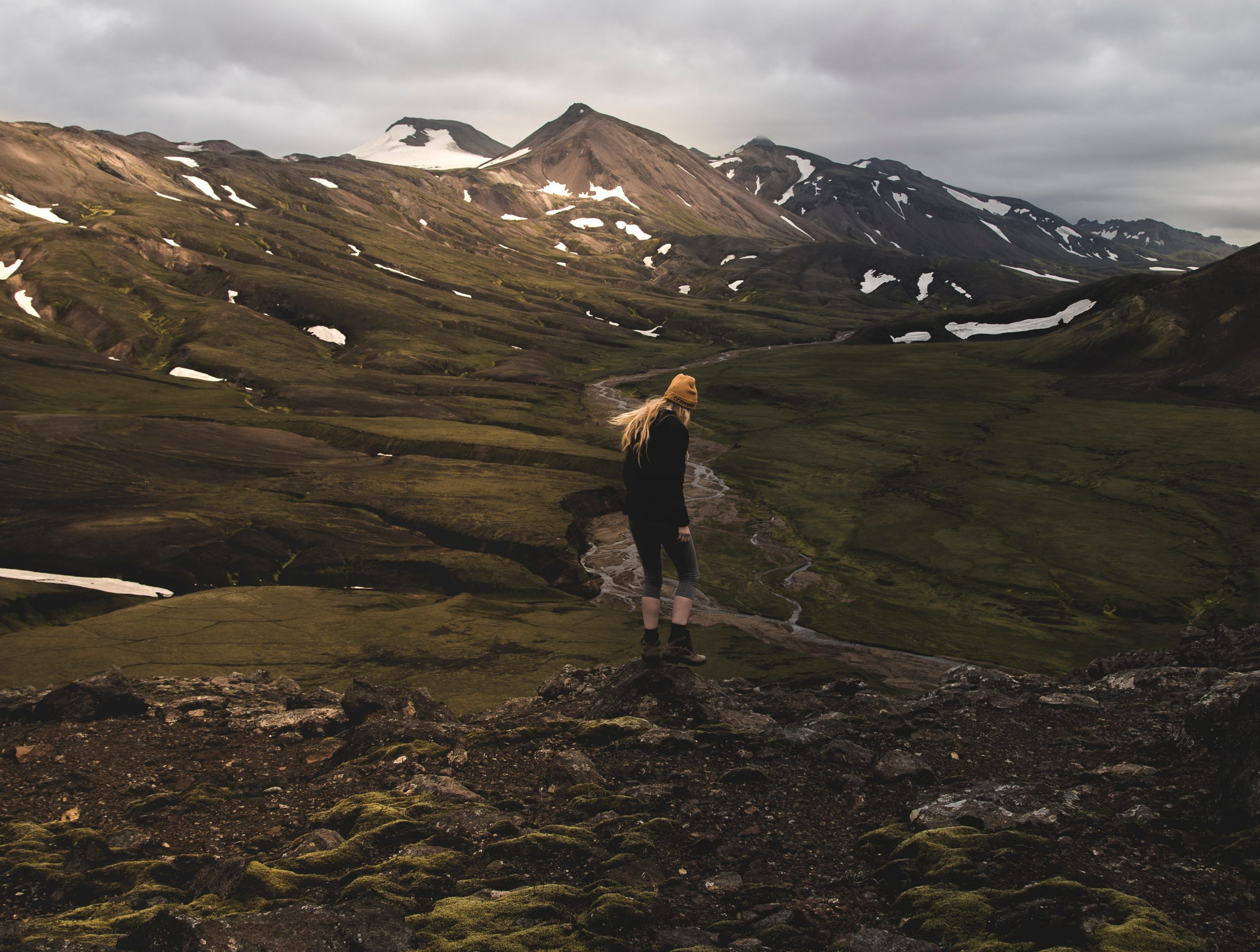 A woman hiking in Iceland's highlands.