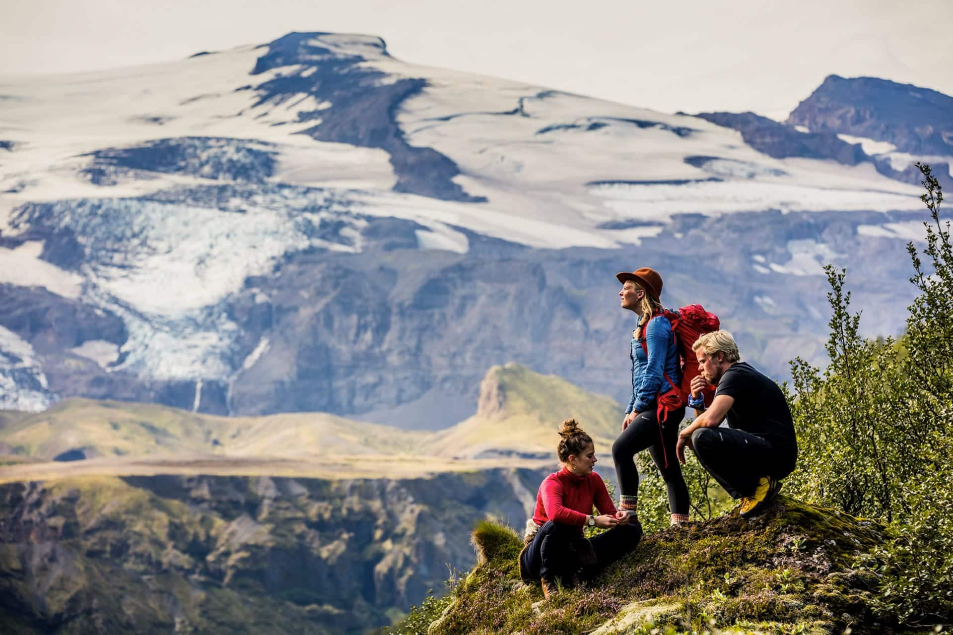 Three people on a ledge in Thorsmork Valley.