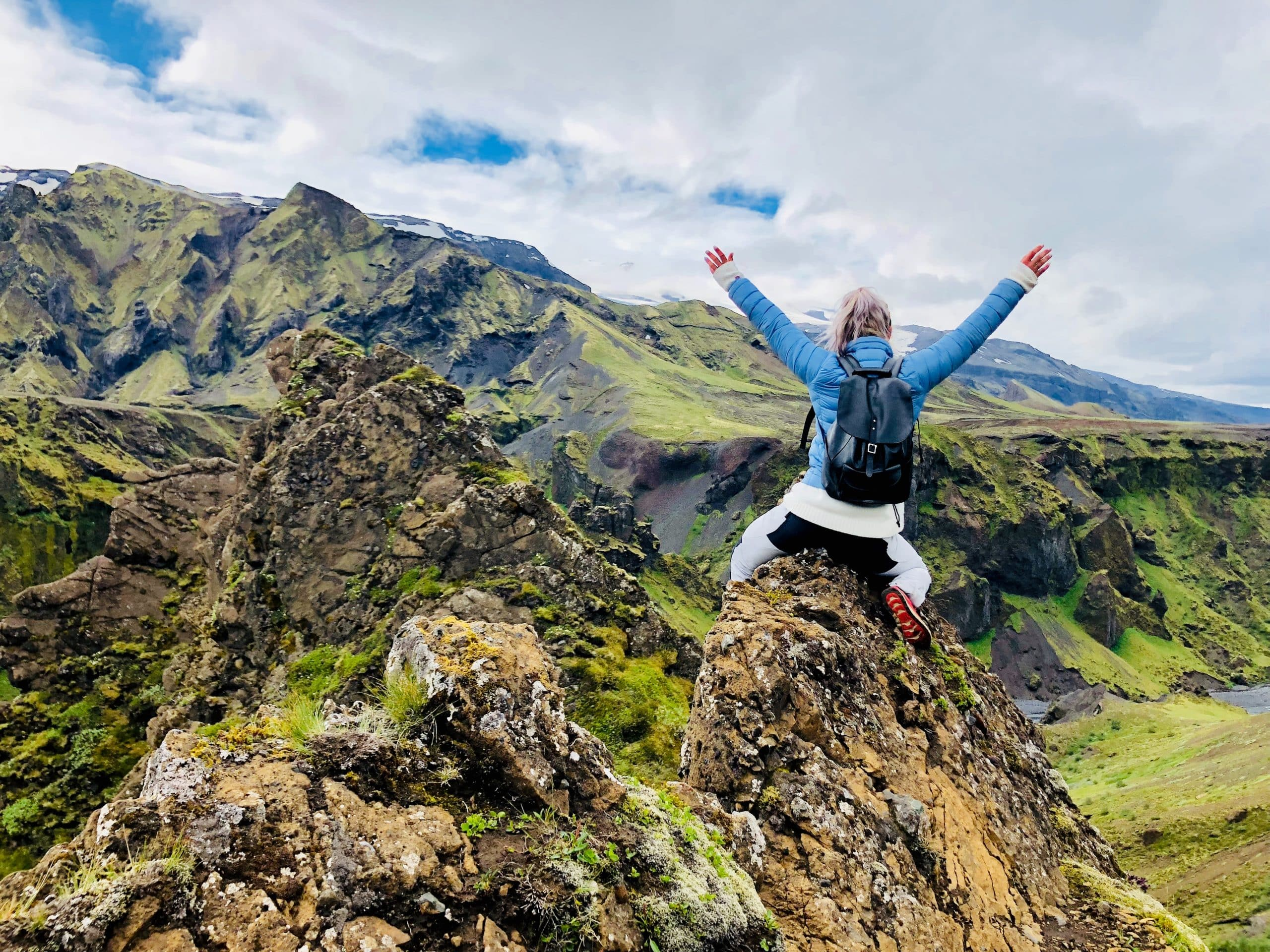 A wooman sitting on a rock in Thorsmork Valley in Iceland's Highlands.
