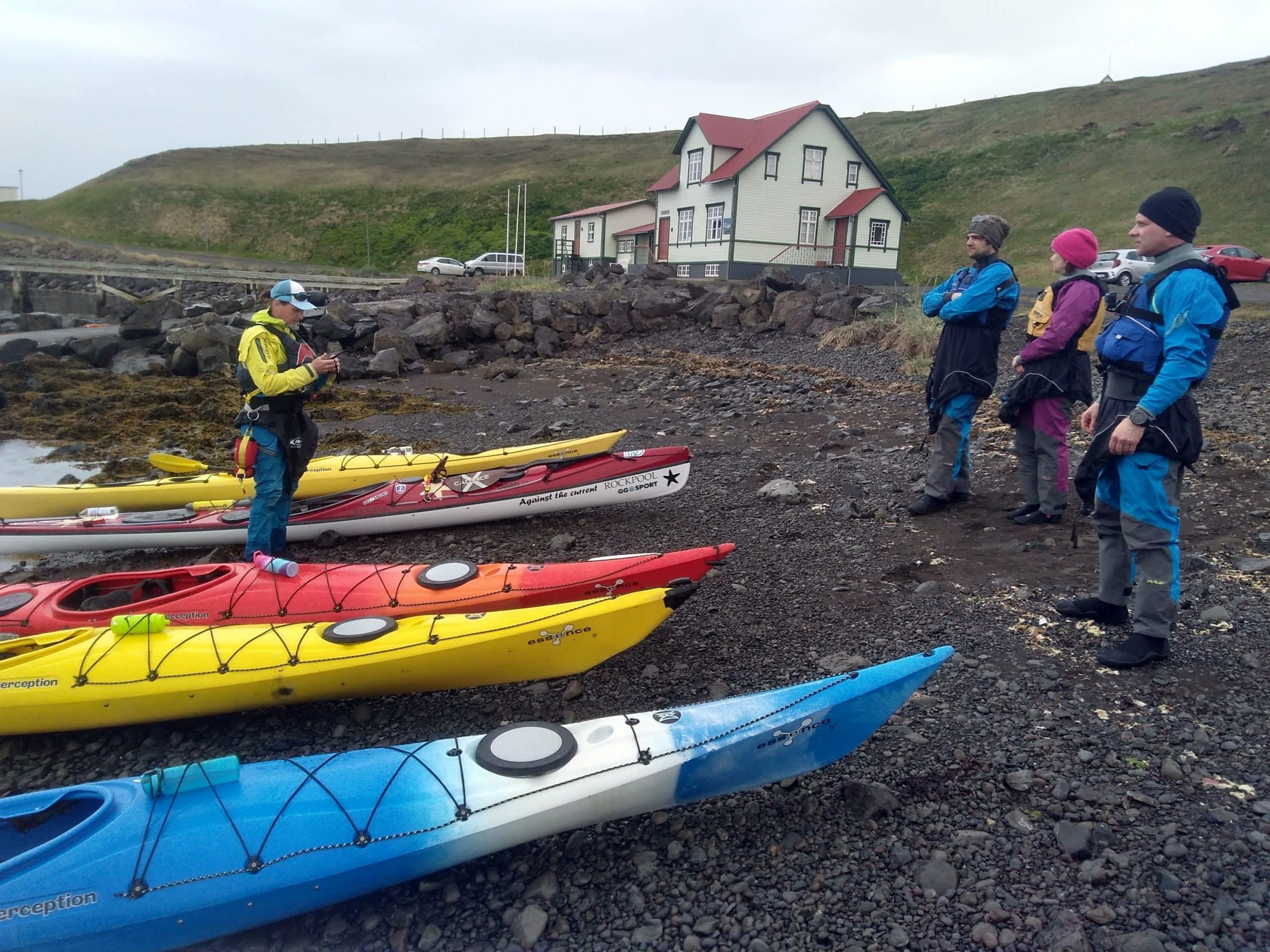 Kayakers and kayaks in Hofsós harbour in North Iceland.