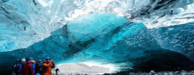 Crystal blue ice cave under a glacier