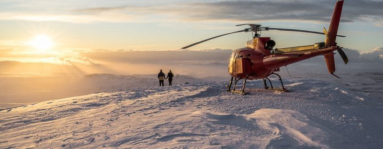 A helecopter on snowy surface.