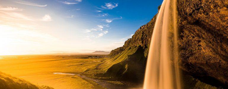 Seljalandsfoss waterfall in the sunlight.