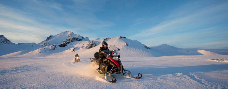 snowmobiles under the sun on Langjokull glacier in Iceland